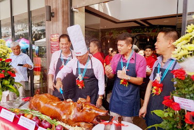 Rico Dionson celebrates the opening of Rico's Lechon at Axis Entertainment Avenue