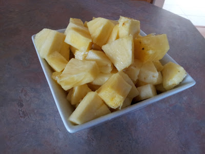 A bowl of freshly cut pineapple