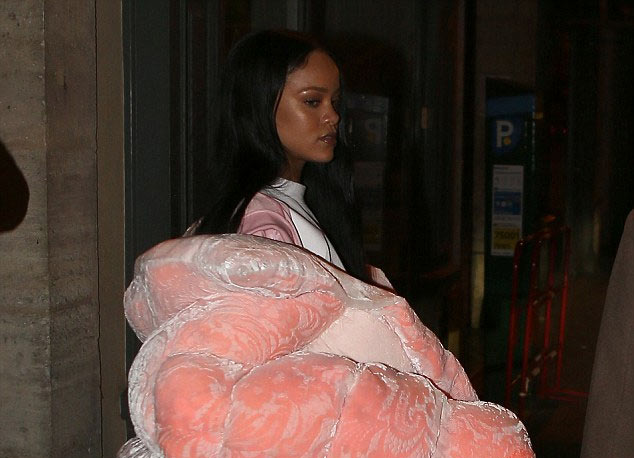 Sexy or trashy? Rihanna steps out in large candy jacket