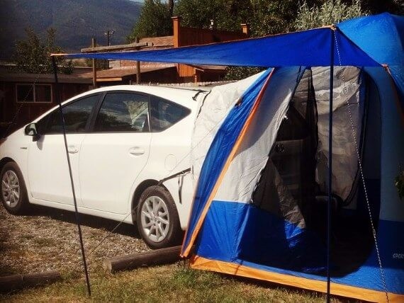 White Prius with tent attached to open rear hatch