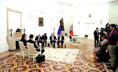 Russian and Slovenian Presidents and diplomats.