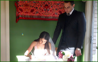 Nazia signs a certificate of marriage as her new husband Nillarn looks on The Heart Garden  Weston ACT Saturday 22 September 2018