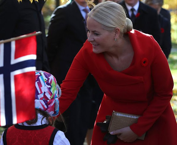 Crown Princess Mette-Marit wore Alexander Mcqueen Dress Coat, Gianvito Rossi pumps, clutch bag