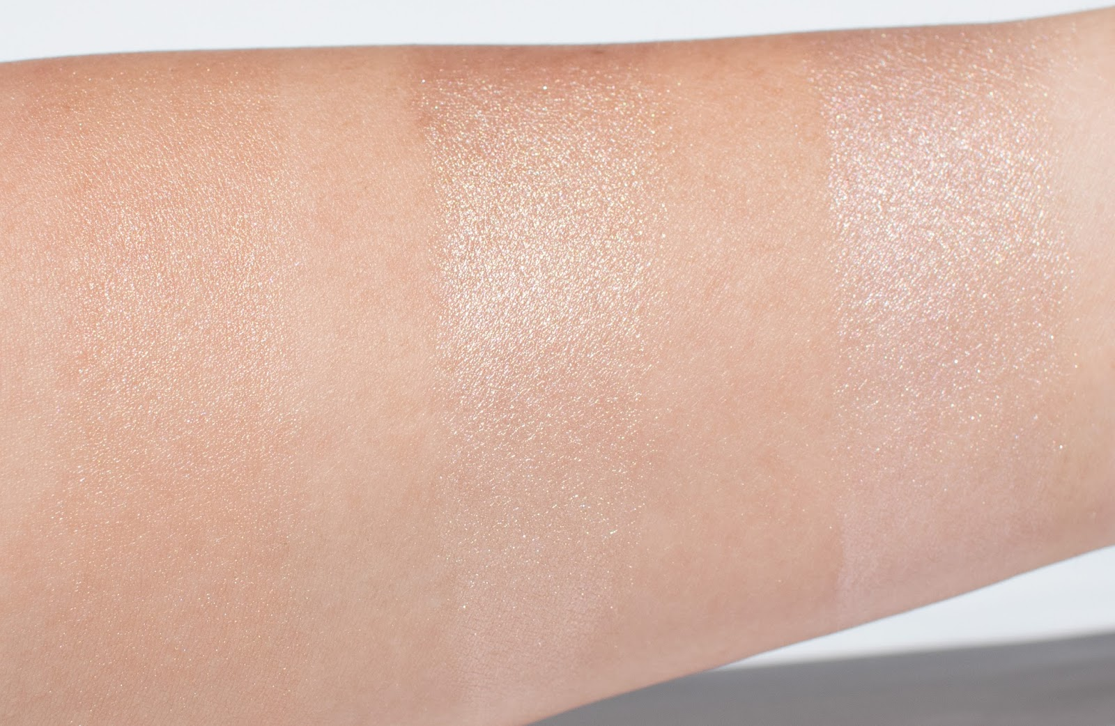 Becca Shimmering Skin Perfector Liquid Highlighter in Opal Swatch