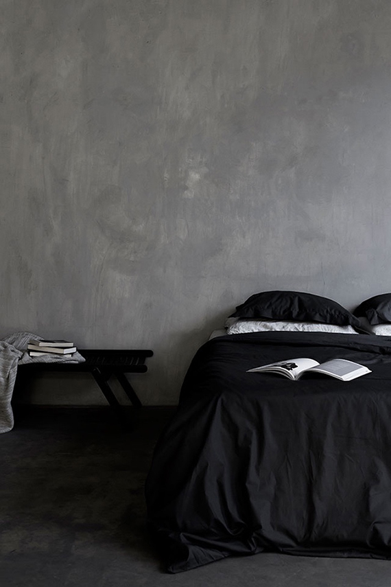 Cozy bedroom in gray hues. Photo by Beeldstein