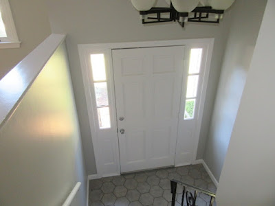 Front entry interior door after painting from stain to white semi gloss in Foxboro, MA.