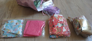 Zip-lock bags of sorted coloured paper