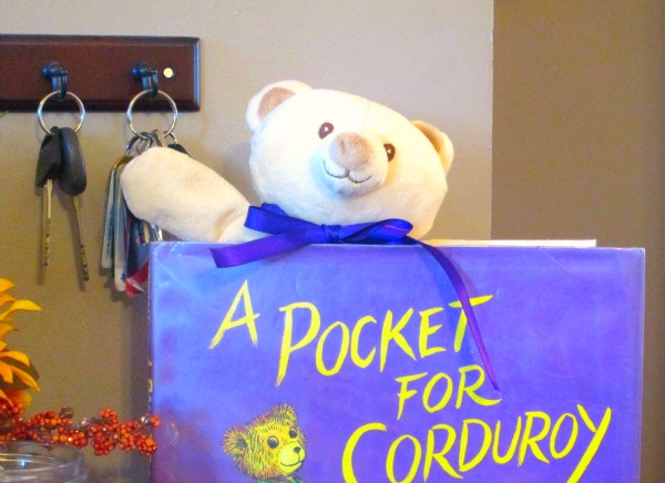 Using library books and teddy bears for decorations at a first birthday party