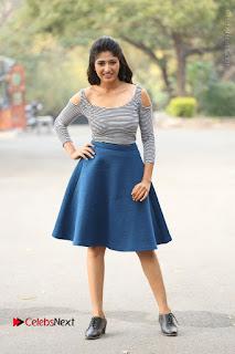 Telugu Actress Roshini Prakash Stills Short Dress at Saptagiri Express Release Press Meet  0270.JPG