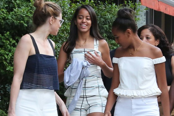 shopping.  Malia Obama and Sasha elaborate walke