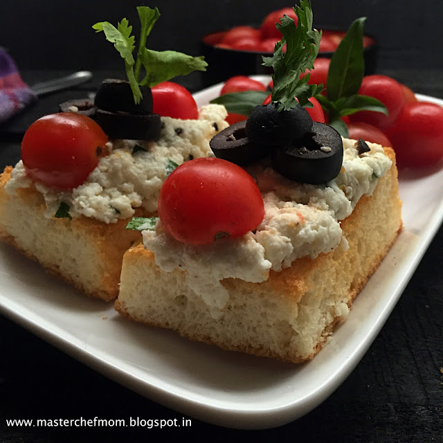 Italian Ricotta Crostini with Olives and Cherry Tomatoes