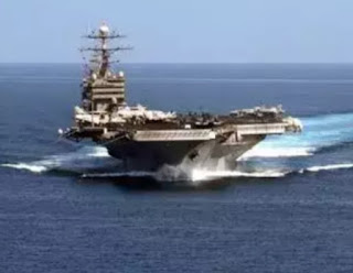IRAN has deployed warships as the US dispatched a carrier strike group to the Persian Gulf amid rising tensions between the two nations.