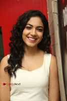 Actress Ritu Varma Stills in White Floral Short Dress at Kesava Movie Success Meet .COM 0130.JPG