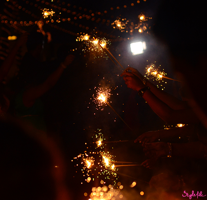 An image of sparklers and fireworks at a wedding celebration on a summer holiday break in Goa, India