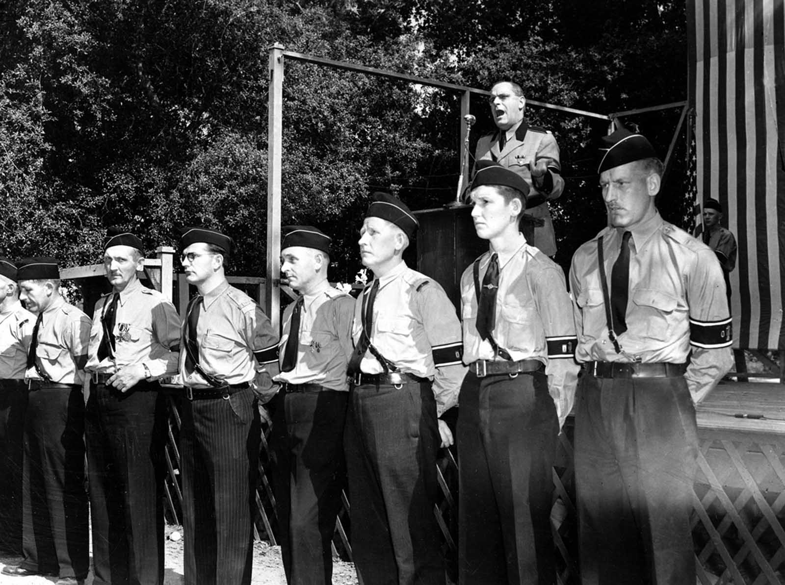 Members of the German-American Bund form a guard of honor before the speaker's stand as Fritz Kuhn, leader of the Bund, addresses a crowd at Hindenberg Park, La Crescenta, near Los Angeles, California, on April 30, 1939.