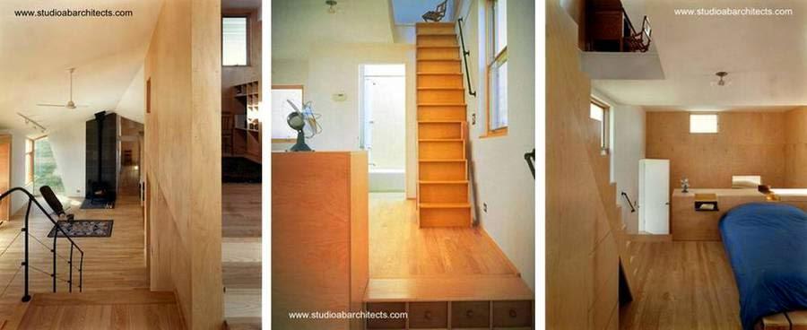 Escaleras interiores de madera en la casa de campo posmoderna