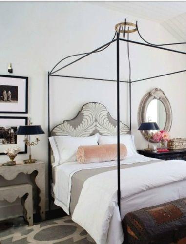 Elegant iron poster bed in bedroom by Eleanor Cummings