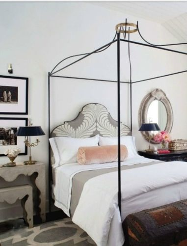 Elegant iron poster bed in bedroom by Eleanor Cummings