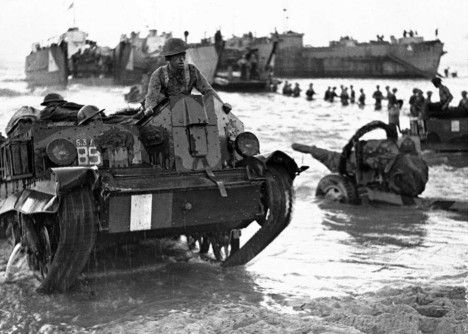 In July of 1943, Allied Forces' troops, guns and transport are rushed ashore, ready for action, at the opening of the Allied invasion of the Italian island of Sicily.