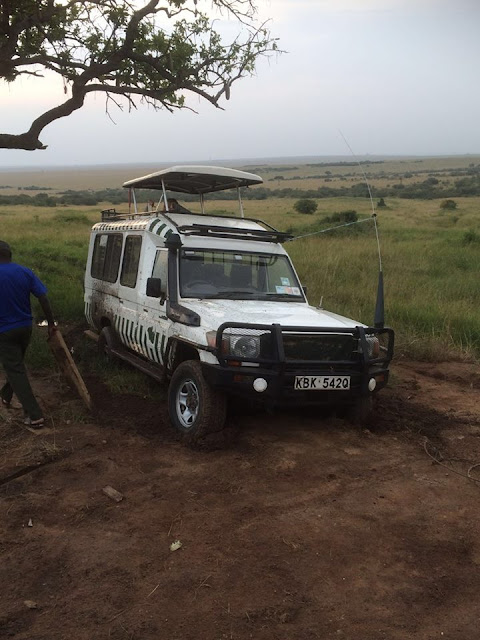 safari vehicle wedged in a ditch masai mara