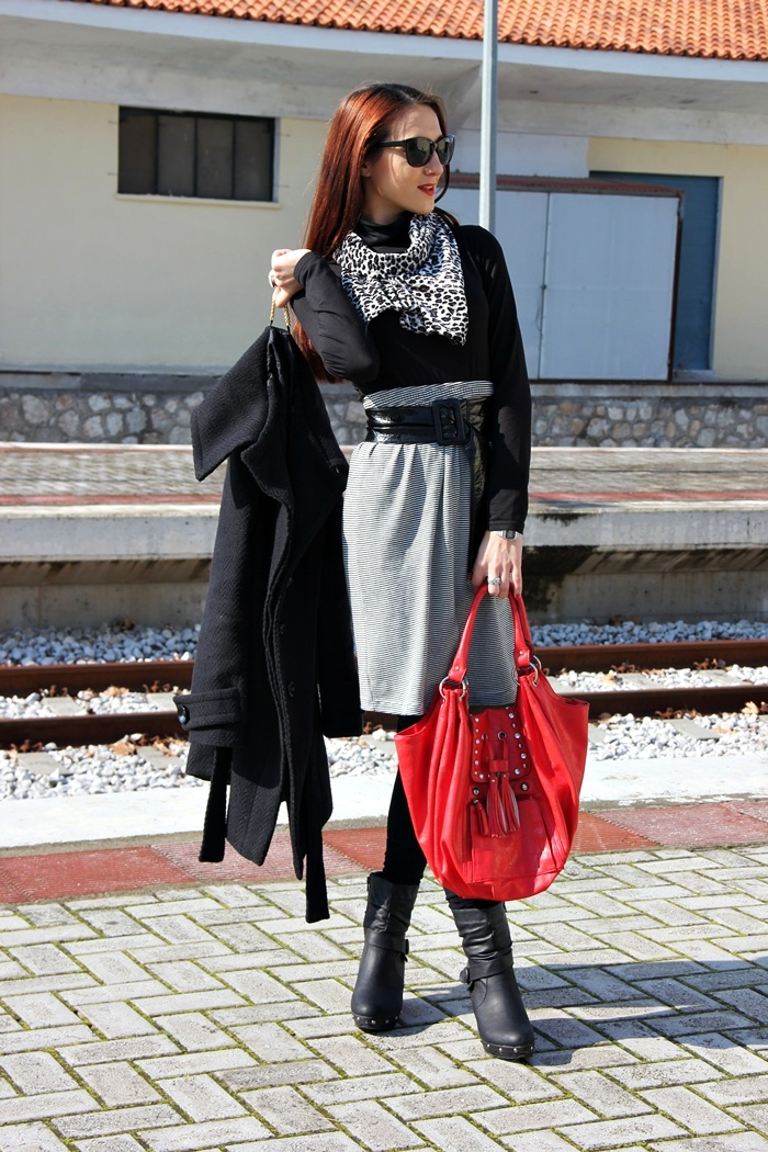 red leather tote bag and black outfit