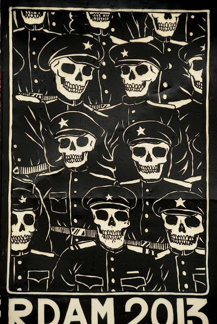 details of street art piece by broken fingaz in amsterdam - skulls with hats