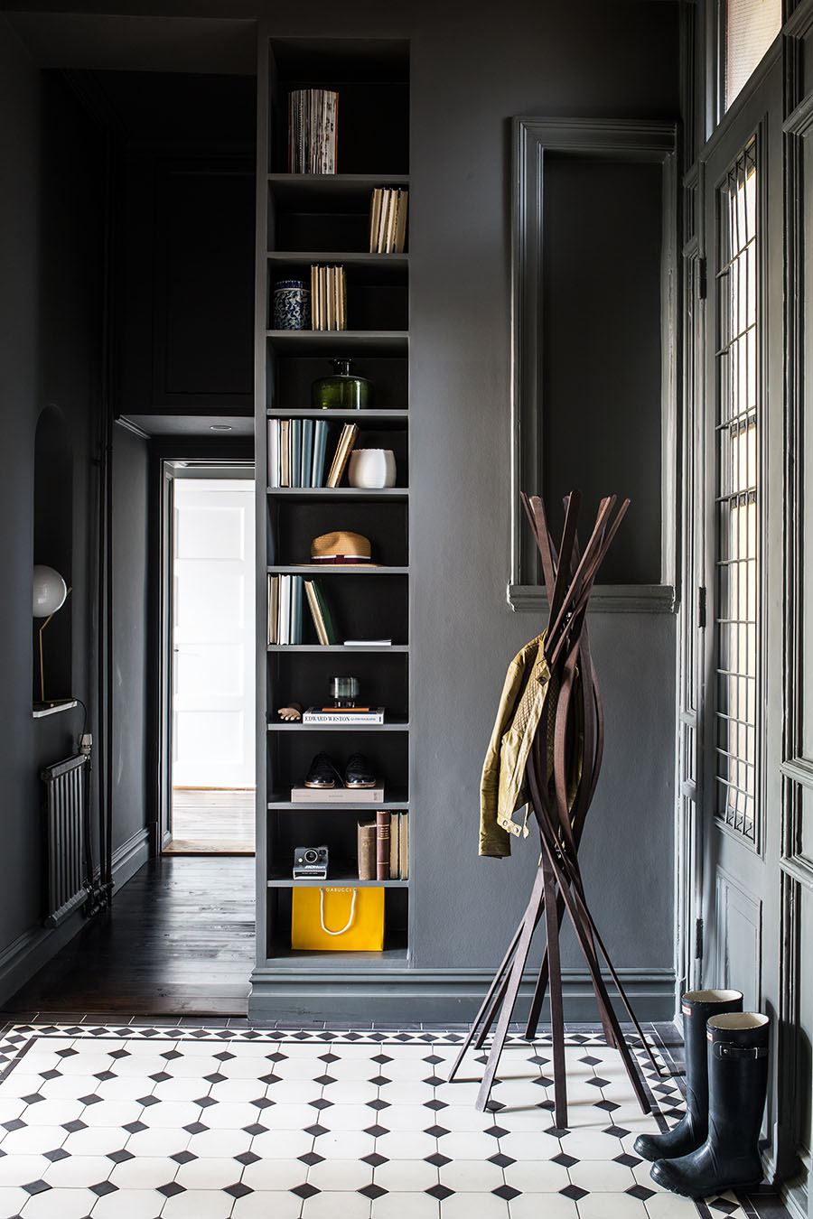 Entry hall, gray painted walls, black and white floor tiles