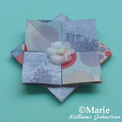 Paper rosette in blue scrapbook papers