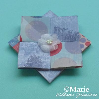 Paper rosette in blue scrapbook papers