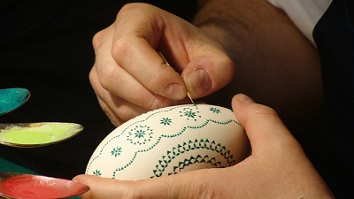 Woman Showing How to Paint a Hard-Boiled Egg With a Toothpick