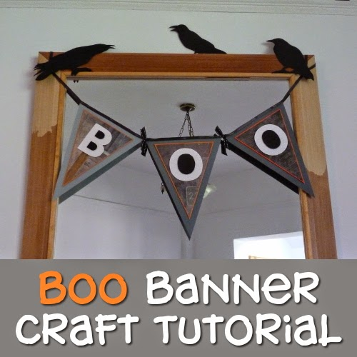 Paper handmade Boo garland hung across a mirror as decoration