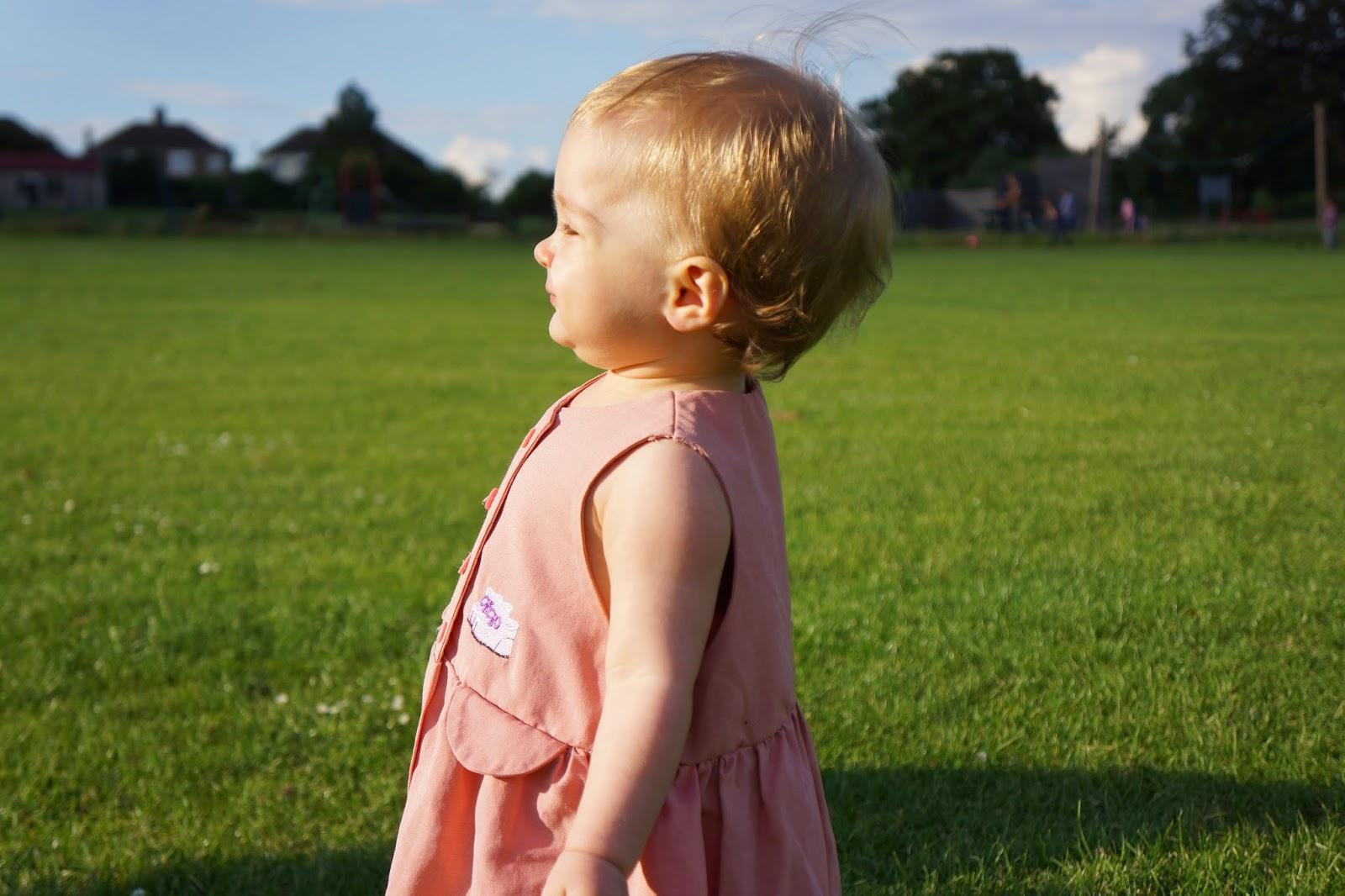toddler girl basking in sunlight