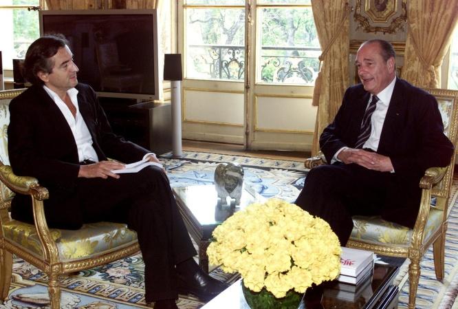 © JACK DABAGHIAN —Source: AFP—Bernard-Henri Lévy à l'Elysée le 3 avril 2002