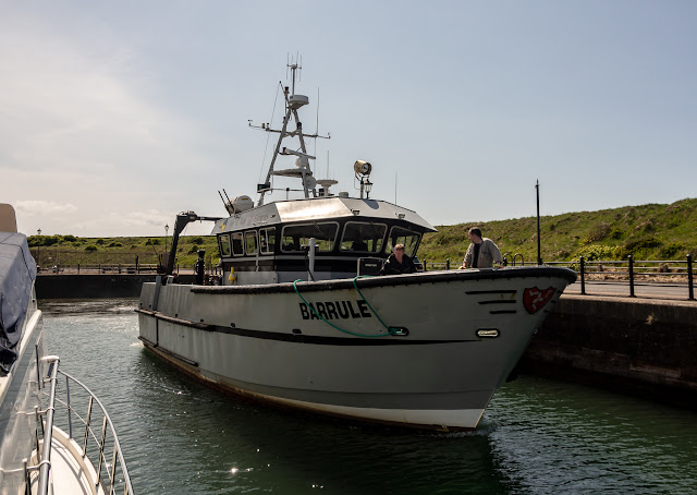 Photo of Barrule heading out of the marina