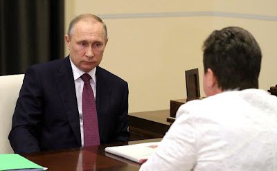 Vladimir Putin at a meeting with Governor of Vladimir Region Svetlana Orlova.
