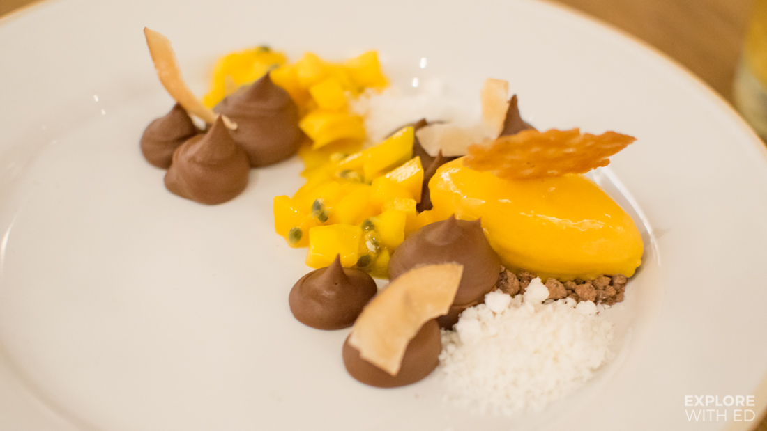 Dark chocolate cremeux with mango sorbet and coconut crumbs