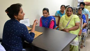 Inspector Jaismeen Kaur counseling the parties in woman cell operational in district administration complex