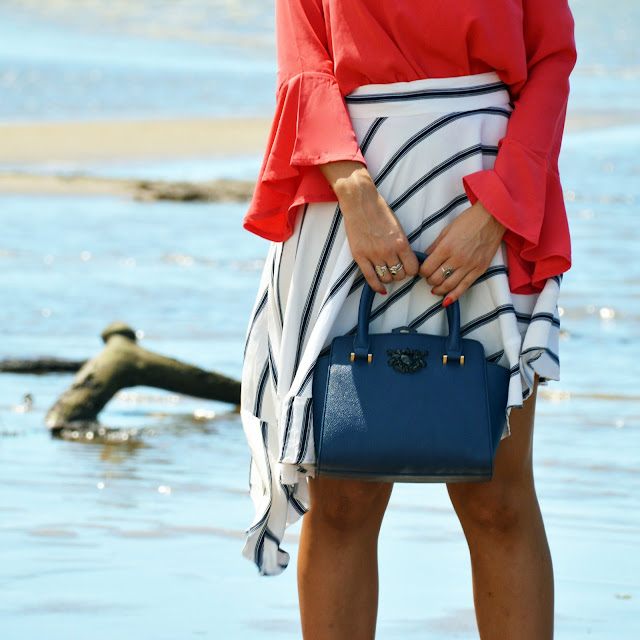 flare sleeved top tucked into assymetric stripe skirt summer style
