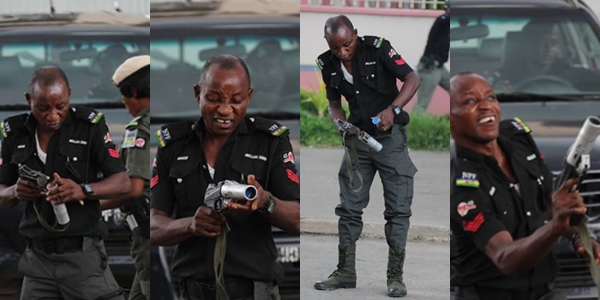 Funny looking Policeman trying to fire teargas at PDP leaders