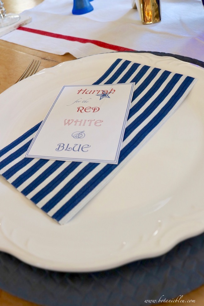 set a patriotic stars and stripes place setting with a special holiday quote