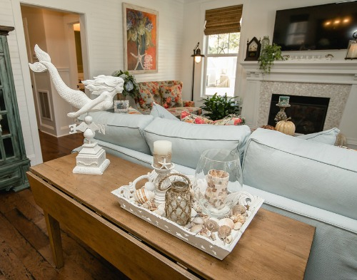 heres the full view of the cottages living room the mermaid figurine is sold at beachcrest home - Cottage Decor