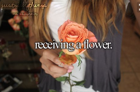 just girly things receiving a flower