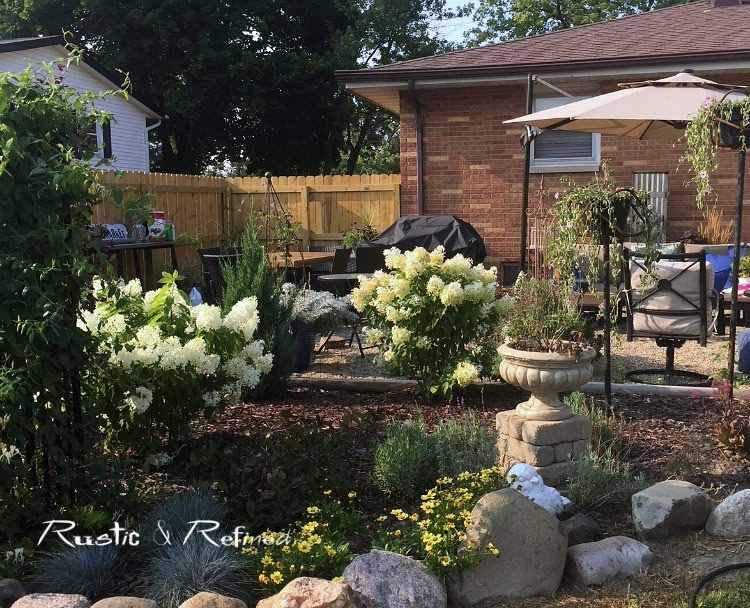 Creating a backyard patio on a budget with a high priced view.