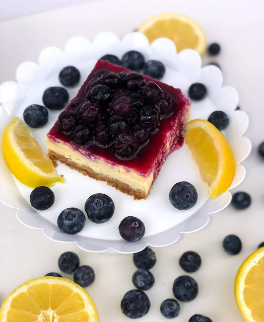 Lemon blueberry cheesecake bars recipes. Lemon cheesecake with blueberry topping and graham cracker crust.