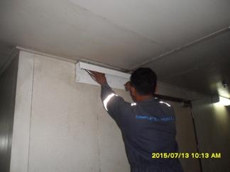 Installing lamp in corridor area 1