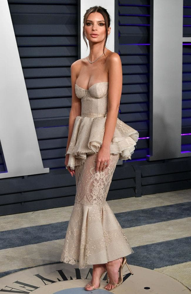 Emily Ratajkowski smoulders in strapless gown at the 2019 Vanity Fair Oscars Party