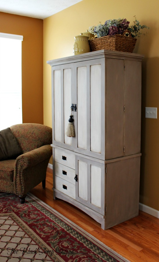 Side view of painted TV armoire.