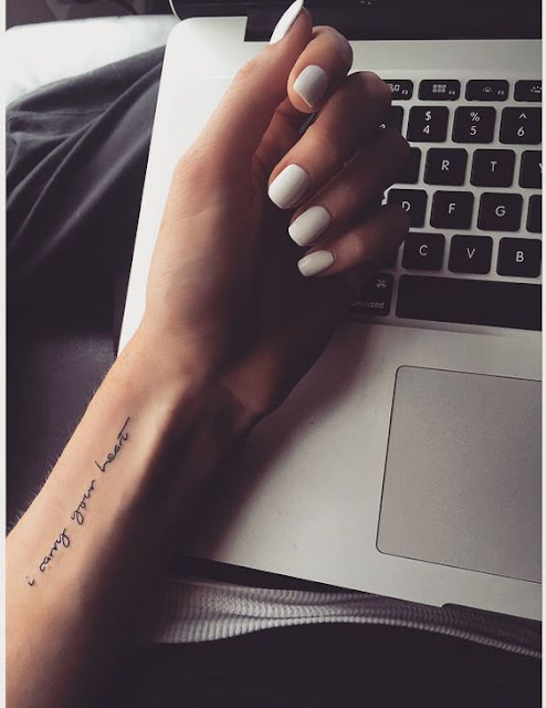 Lovely Symbol Wrist Tattoos For Girls