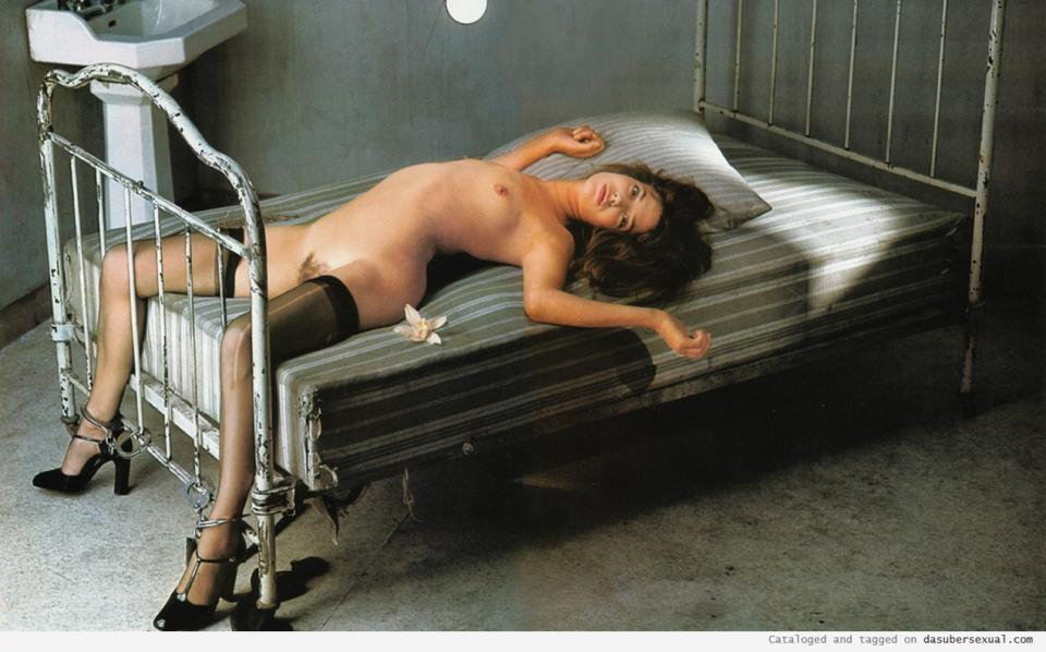 woman chained to bed naked