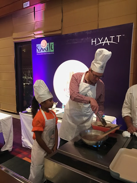 Mr. David Lelliott OBE-British High Commission Chandigarh preparing his dish 'Toad in the Hole with Onion Gravy'
